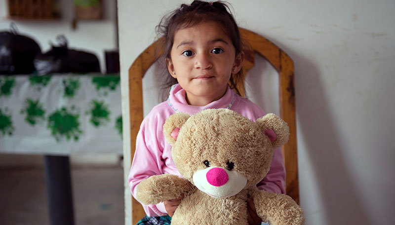 Estefania holds her favorite toy