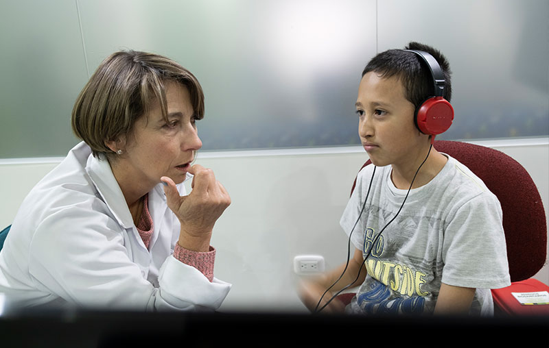 Maria with a speech therapy patient