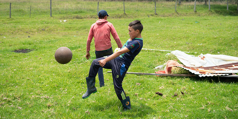 Neitan plays football with his brother